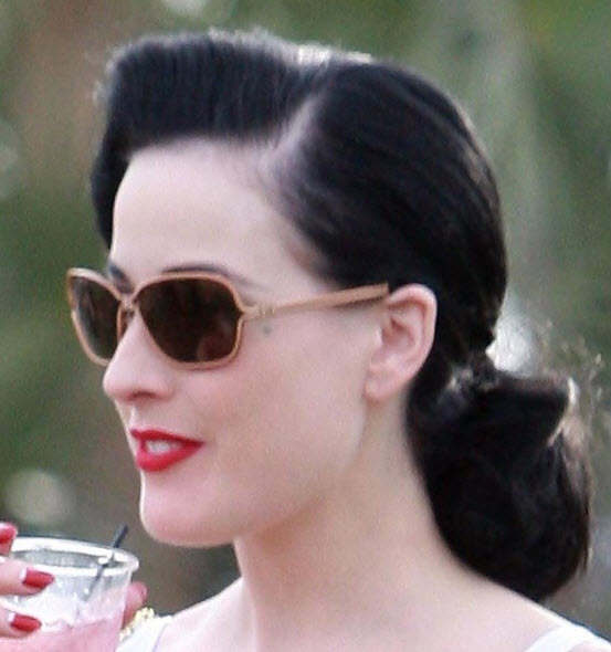 Dita-Von-Teese-retro-jet-black-updo-with-a-low-curly-ponytail-and-a-side-part-hairstyle1